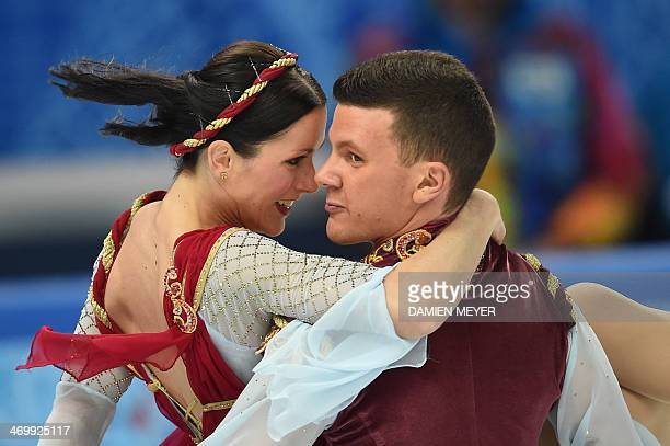 Italy's Charlene Guignard and Italy's Marco Fabbri perform in the Figure Skating Ice Dance Free Dance at the Iceberg Skating Palace during the Sochi...