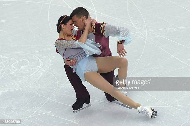 Italy's Charlene Guignard and Italy's Marco Fabbri perform in the Figure Skating Team Ice Dance Free Dance at the Iceberg Skating Palace during the...
