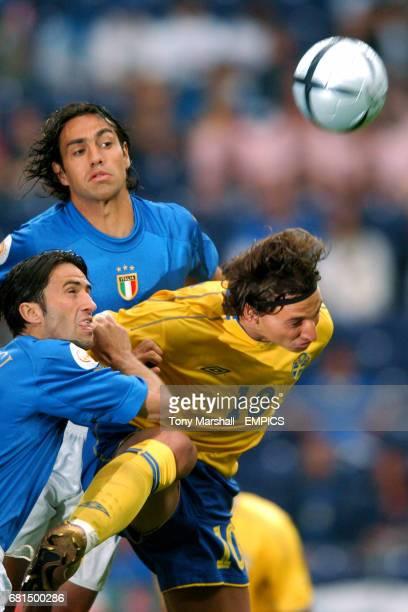 Italy's Christian Panucci and Alessandro Nesta combine to deny Sweden's Zlatan Ibrahimovic