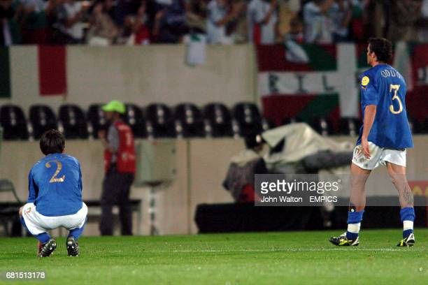 Italy's Christian Panucci and Massimo Oddo are dejected at the final whistle