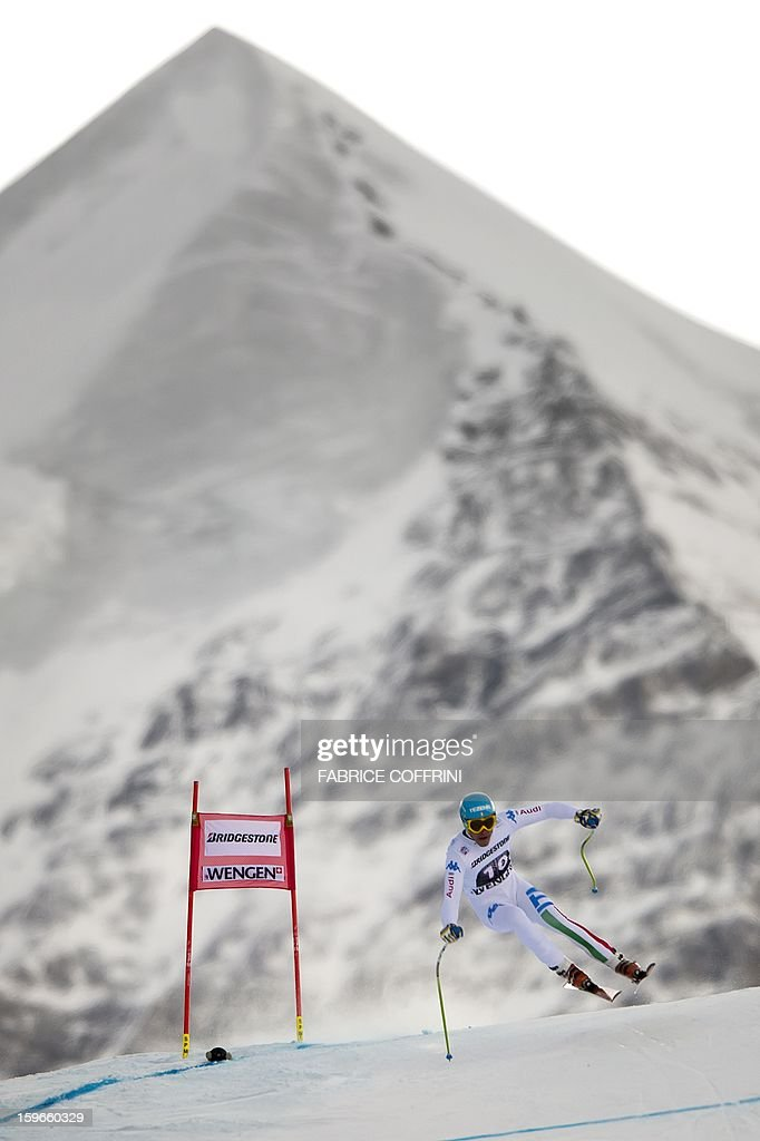 Italy's Christof Innerhofer leaps on January 18, 2013 in front of the Silberhorn mountain during the downhill event of the men's super combined of the FIS Alpine Skiing World Cup in Wengen. AFP PHOTO / FABRICE COFFRINI