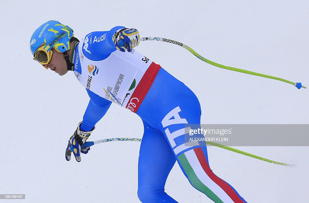 Italy's Christof Innerhofer reacts after competing during the men's Super-G event of the 2013 Ski World Championships in Schladming, Austria on February 6, 2013. AFP PHOTO / ALEXANDER KLEIN