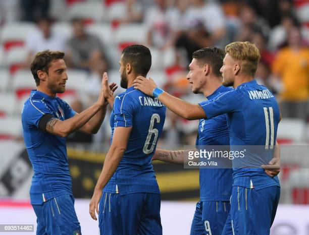 Italy's Claudio Marchisio Antonio Candreva Ciro immobile and striker Andrea Belotti celebrate after scoring a goal during the International Friendly...