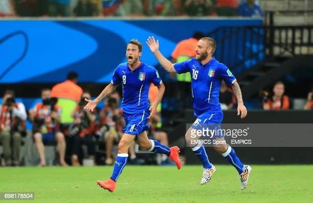 Italy's Claudio Marchisio celebrates scoring his side's first goal of the game with teammate Daniele de Rossi during the FIFA World Cup Group D match...