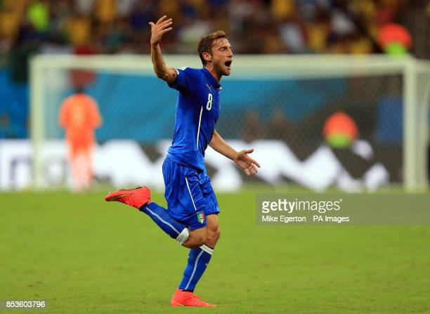 Italy's Claudio Marchisio celebrates scoring his side's first goal of the game during the FIFA World Cup Group D match at the Arena da Amazonia...