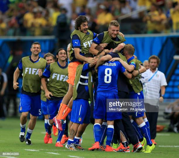 Italy's Claudio Marchisio celebrates scoring his side's first goal of the game with teammates during the FIFA World Cup Group D match at the Arena da...