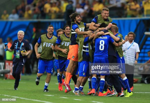 Italy's Claudio Marchisio celebrates scoring his side's first goal of the game with teammates