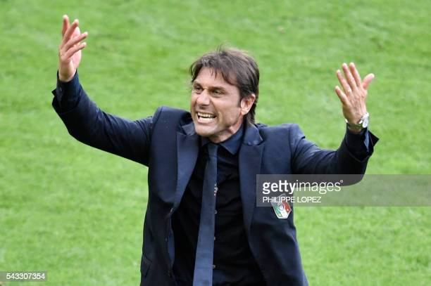 Italy's coach Antonio Conte gestures during Euro 2016 round of 16 football match between Italy and Spain at the Stade de France stadium in SaintDenis...
