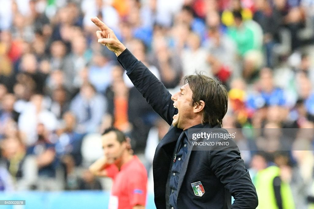 Italy's coach Antonio Conte reacts during the Euro 2016 round of 16 football match between Italy and Spain at the Stade de France stadium in Saint-Denis, near Paris, on June 27, 2016. / AFP / VINCENZO