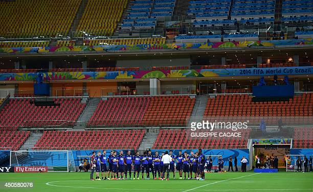 Italy's coach Cesare Prandelli talks to his players during a training session at the Arena Amazonia Stadium on June 13 on the eve of their 2014 FIFA...