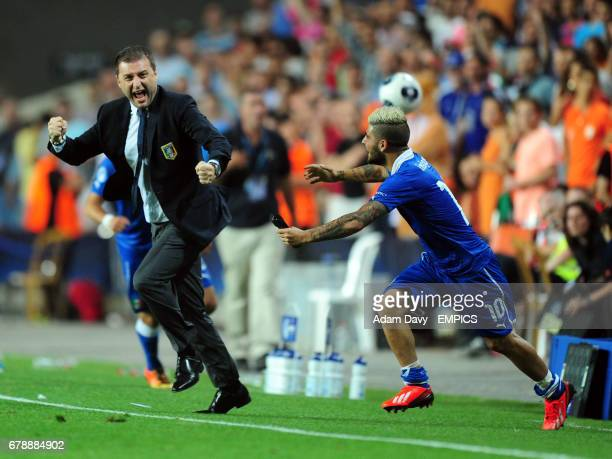 Italy's coach Devis Mangia and Lorenzo Insigne celebrate their victory on the final whistle