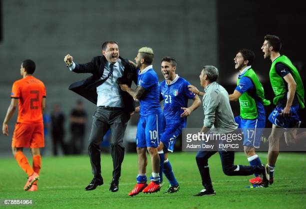 Italy's coach Devis Mangia celebrates with the players at the final whistle