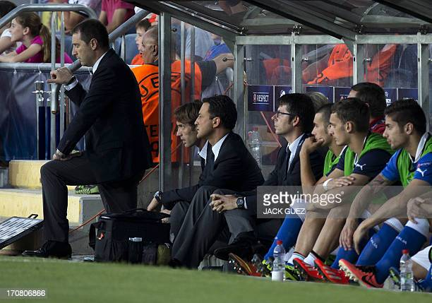 Italy's coach Devis Mangia stands next to staff members and substitute players during the 2013 UEFA U21 Championship final football match between...