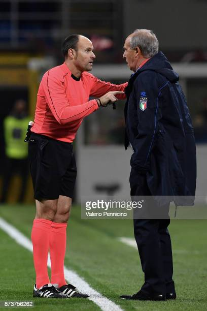 Italy's coach GianPiero Ventura argues with Spanish referee Antonio Mateu Lahoz during the FIFA 2018 World Cup Qualifier PlayOff Second Leg between...