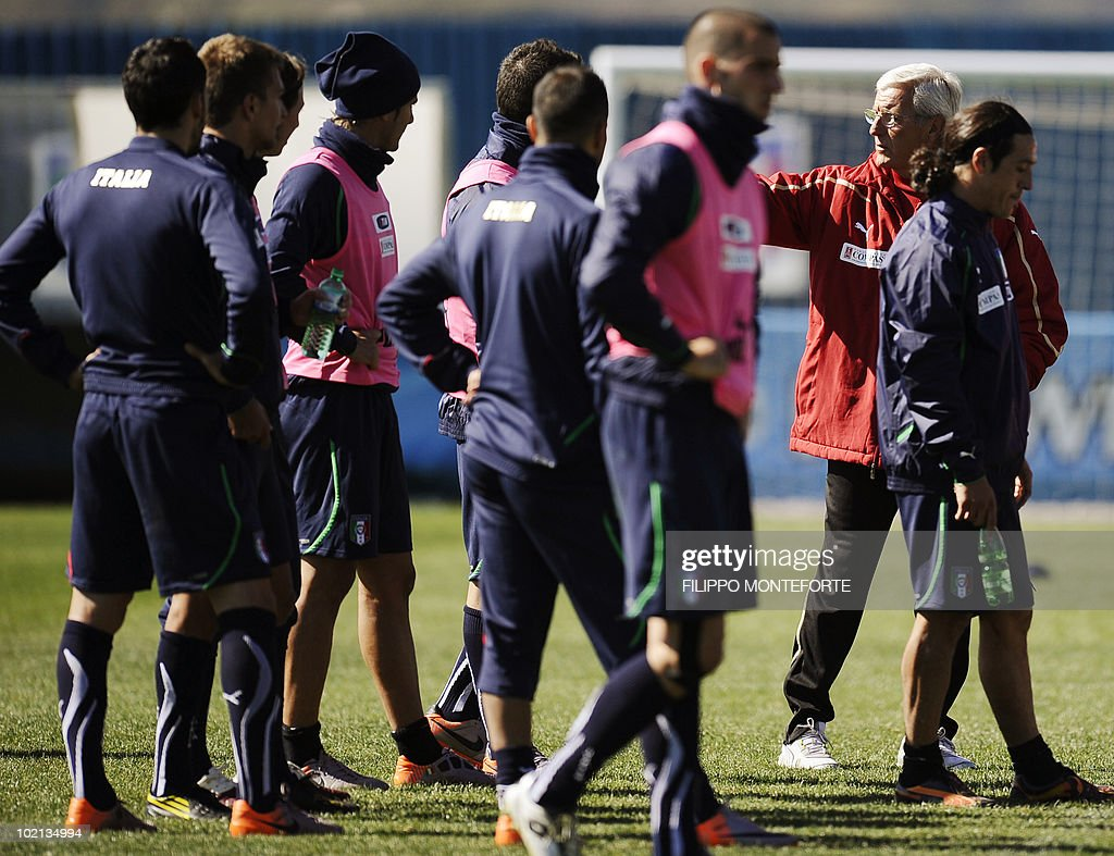 Italy's coach Marcello Lippi (2nd R) gestures near his players during a training session at Irene's Southdowns College, south of Pretoria on June 16, 2010. Coach Marcello Lippi was calm and confident on June 15 despite reigning champions Italy's failure to win their opening match of the 2010 Football World Cup.