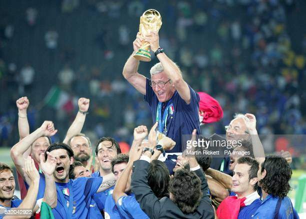 Italy's coach Marcelo Lippi celebrates with the trophy