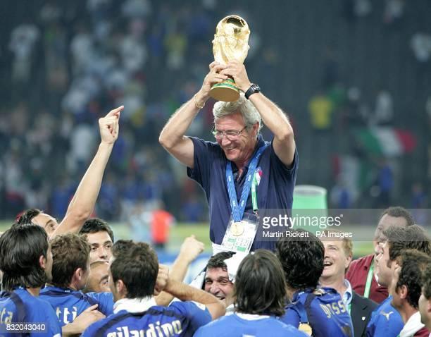 Italy's coach Marcelo Lippi holds the trophy aloft