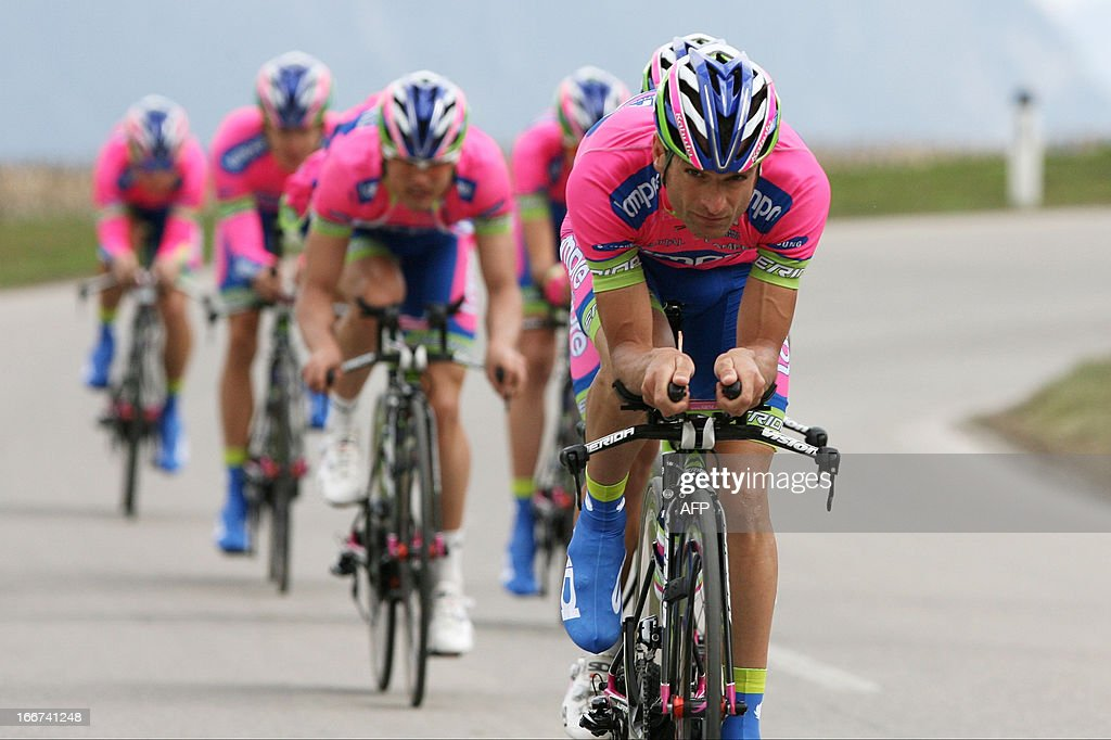 Italy's cyclist Michele Scarponi (front) of Lampre-Merida team rides during the training of the Team Time Trial of 14.1 km of the cycling road race 'Giro del Trentino' in Lienz, on April 16, 2013.