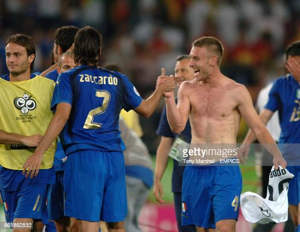 Italy's Daniele De Rossi and Cristian Zaccardo celebrates their sides win