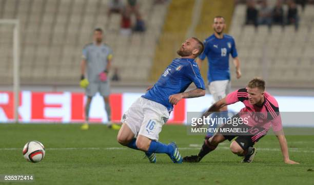 Italy's Daniele De Rossi is tackled by Scotland's Matt Richie during the International friendly football match Italy vs Scotland at the National...