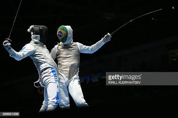 Italy's Daniele Garozzo competes against Brazil's Ghislain Perrier during the mens team foil quarterfinal bout between Italy and Brazil as part of...