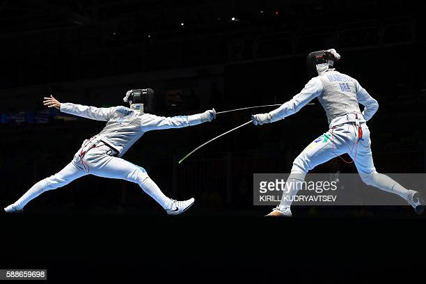 TOPSHOT Italy's Daniele Garozzo competes against Brazil's Henrique Marques during the mens team foil quarterfinal bout between Italy and Brazil as...