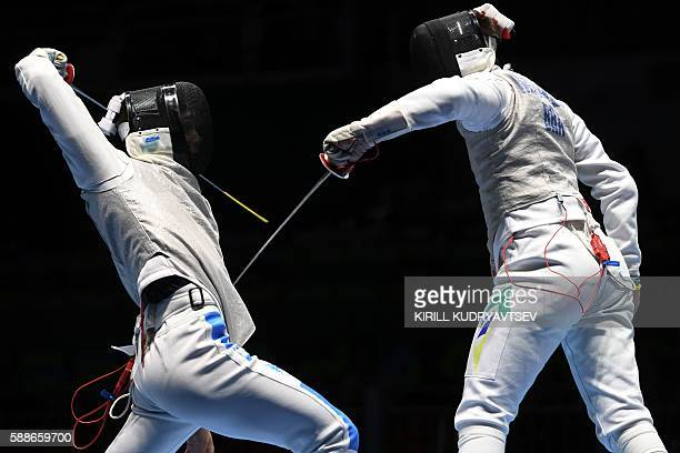 Italy's Daniele Garozzo competes against Brazil's Henrique Marques during the mens team foil quarterfinal bout between Italy and Brazil as part of...