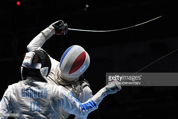 Italy's Daniele Garozzo competes against France's Enzo Lefort during the mens team foil semifinal bout between Italy and France as part of the...