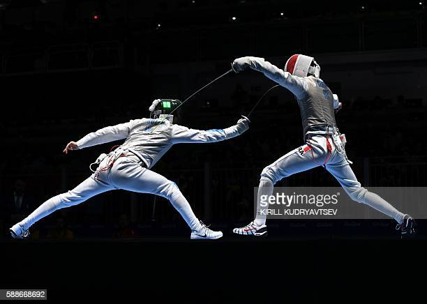 Italy's Daniele Garozzo competes against France's Jeremy Cadot during the mens team foil semifinal bout between Italy and France as part of the...