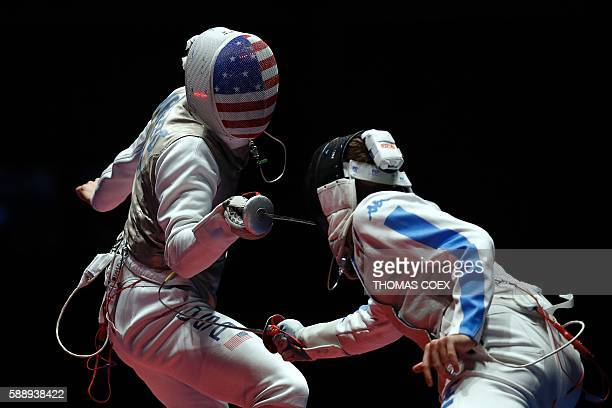Italy's Daniele Garozzo competes against US Gerek Meinhardt during the mens team foil bronze medal bout between Italy and US as part of the fencing...