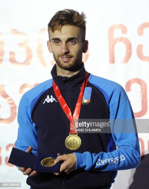 Italy's Daniele Garozzo poses with his gold medal on the podium after winning the men's individual Foil competition at the European Fencing Senior...