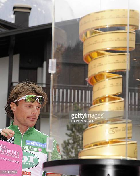 Italy's Danilo Di Luca is pictured close to Giro of Italy 's trophy prior the fifth stage of the 92nd Giro of Italy between San Martino di Castrozza...