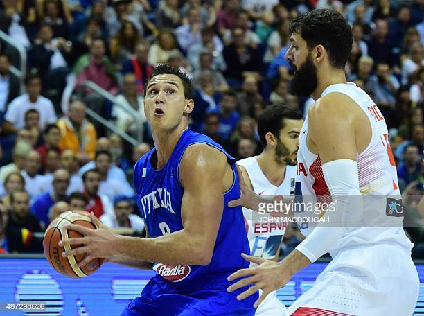 Italy's Danilo Gallinari lines up a shot in front of Spain's Nikola Mirotic during the EuroBasket group B match Spain vs Italy in Berlin September 8...
