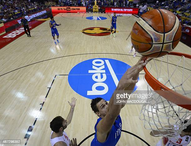 Italy's Danilo Gallinari tries to score during the EuroBasket group B match Spain vs Italy in Berlin September 8 2015 AFP PHOTO / JOHN MACDOUGALL