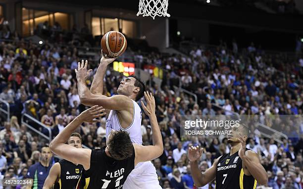 Italy's Danilo Gallinari tries to score during the EuroBasket group B match Italy vs Germany in Berlin September 9 2015 AFP PHOTO / TOBIAS SCHWARZ