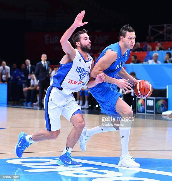 Italy's Danilo Gallinari vies against Israel's Yogev Ohayon during the EuroBasket 2015 Round of 16 match between Israel and Italy at the Pierre...