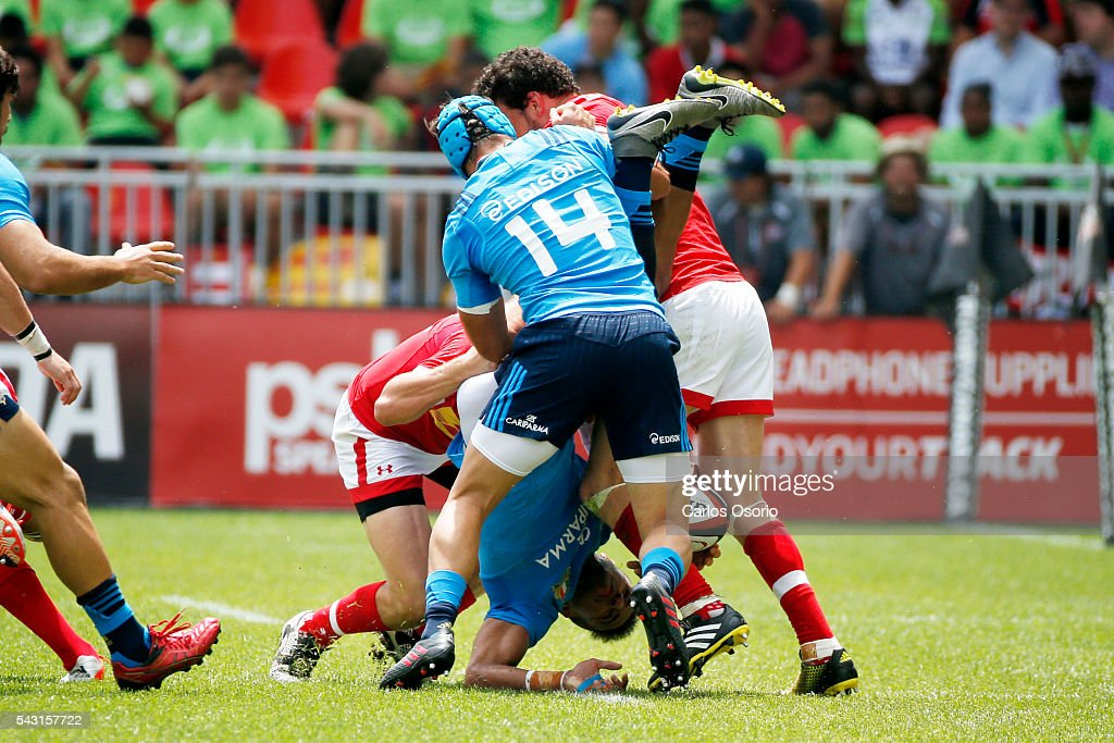 TORONTO, ON - JUNE 26 - Italy's David Odiete is flipped upside down during the first half of Rugby action as Canadas Mens Rugby Team takes on Italy in a Rugby World Cup (RWC) 2015 re-match on Sunday at BMO field in downtown Toronto June 26, 2016.