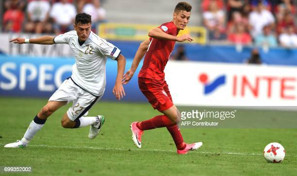 Italy's defender Alex Ferrari and Czech Republic's midfielder Patrik Schick vie for the ball during the UEFA U21 European Championship Group C...
