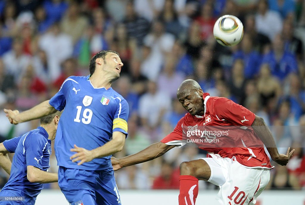 Italy's defender and captain Gianluca Zambrotta (L) fights for the ball with Switzerland's forward Blaise Nkufo during the WC2010 friendly football match Switzerland vs Italy at Geneva's stadium on June 5, 2010 ahead of the FIFA 2010 World Cup held in South Africa.
