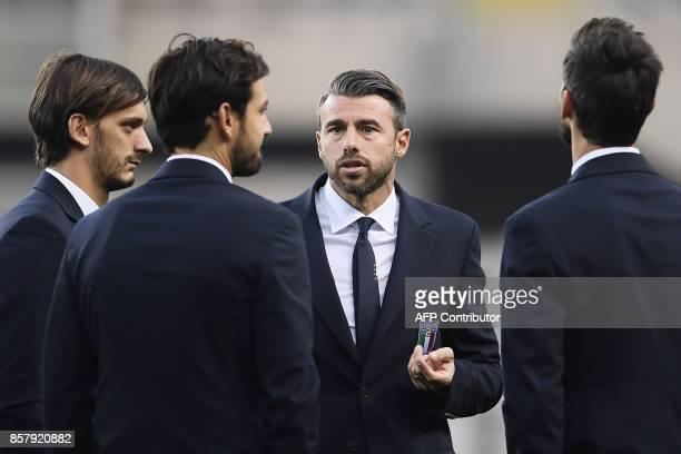 Italy's defender Andrea Barzagli and Italy's forward Manolo Gabbiadini walk around the 'Grande Torino Stadium' on the eve of the FIFA World Cup 2018...