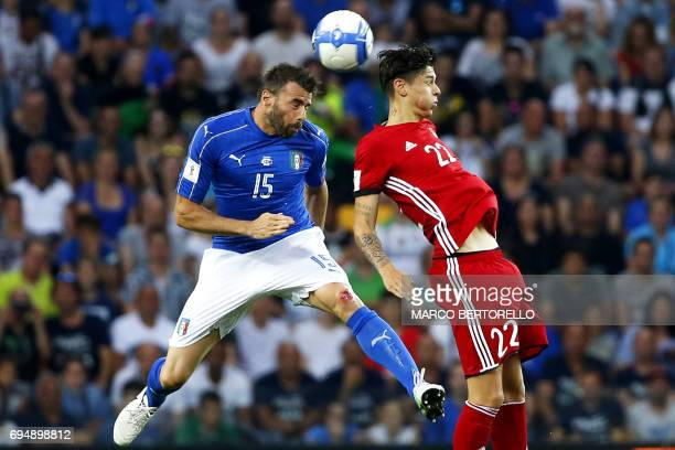 Italy's defender Andrea Barzagli fights for the ball with Liechtenstein's forward Yanik Frick during the FIFA WC 2018 football qualification match...