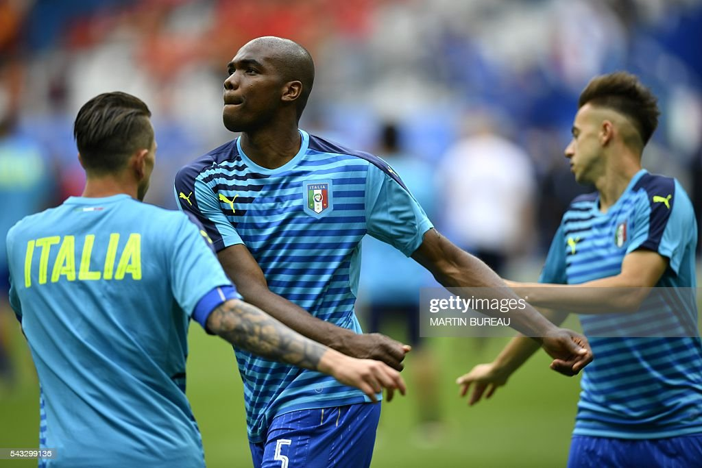 Italy's defender Angelo Ogbonna warms up at the start of Euro 2016 round of 16 football match between Italy and Spain at the Stade de France stadium in Saint-Denis, near Paris, on June 27, 2016. / AFP / MARTIN
