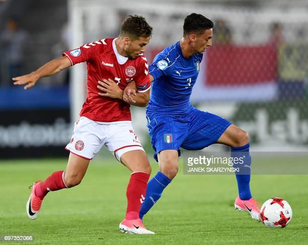 Italy's defender Antonio Barreca and Denmark's midfielder Andrew Hjulsager vie for the ball during the UEFA U21 European Championship Group C...