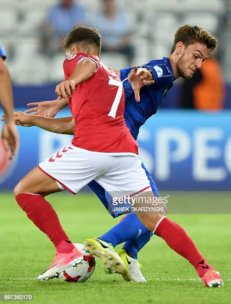 Italy's defender Daniele Rugani and Denmark's midfielder Andrew Hjulsager vie for the ball during the UEFA U21 European Championship Group C football...