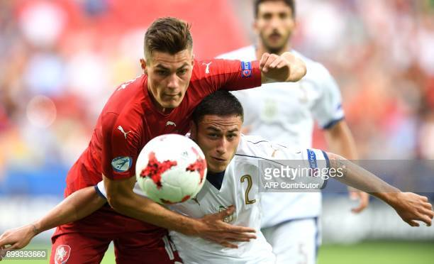 Italy's defender Davide Calabria and Czech Republic's midfielder Patrik Schick vie for the ball during the UEFA U21 European Championship Group C...