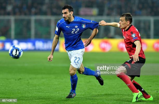 Italy's defender Davide Zappacosta fights for the ball with Albania's midfielder Burim Kukeli during the World Cup 2018 group G qualification...