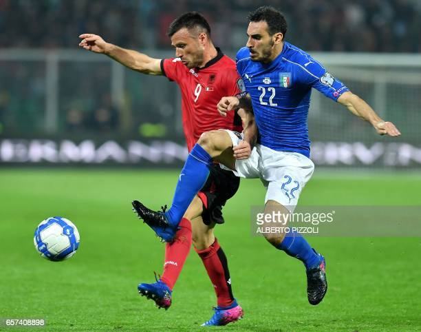 Italy's defender Davide Zappacosta fights for the ball with Albania's midfielder Ledian Memushaj during the World Cup 2018 group G qualification...