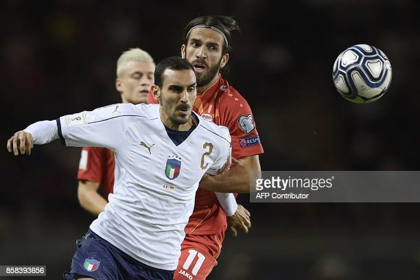 Italy's defender Davide Zappacosta outruns Macedonia's midfielder Feran Hasani during the FIFA World Cup 2018 qualification football match between...