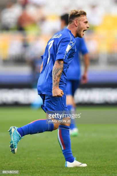 Italy's defender Federico Dimarco celebrates a goal during the U20 World Cup quarterfinal football match between Italy and Zambia in Suwon on June 5...