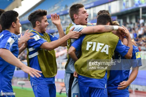 Italy's defender Federico Dimarco celebrates a goal with teammates during the U20 World Cup quarterfinal football match between Italy and Zambia in...